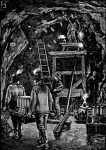 Workers in underground galleries putting cartridges of dynamite into position