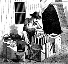 Inserting detonators into cartridges of dynamite for blasting Flood Rock, East River