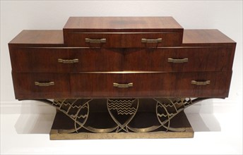 Commode with drawers set on a latticed bronze base, 1933, by Eugène Printz,