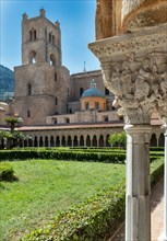 Monreale, Duomo: view of the cloister and the cathedral with the bell tower
