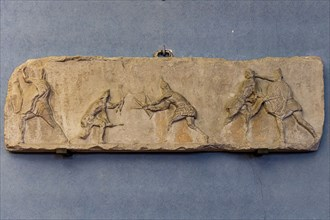 Roman slab representing a Sagittarii fighting