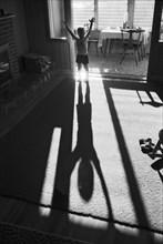Boy Looking at his Shadow