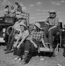 Group of People from Local Ranch watching Crow Fair, Crow Agency, Montana, USA, Marion Post Wolcott for Farm Security Administration, July 1941Marion Post Wolcott for Farm Security Administration,