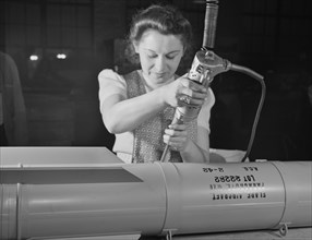 Female Factory Worker, Assembling Flare Casings in Support of War Effort, A.C. Gilbert Company, New Haven, Connecticut, USA, Howard R. Hollem for Office of War Information, February 1942
