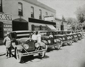 People Posed With Row of Automobiles, USA, 1921