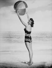 Esther Williams, Publicity Portrait with Beach Ball for the film, Neptune's Daughter, 1949
