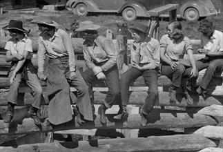 Dude Girls on a Corral Fence, Quarter Circle U Roundup, Montana, USA, Arthur Rothstein, Farm Security Administration, June 1939