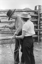 Learning how to Throw a Rope during Ranch Rodeo Contest, Brewster Arnold Quarter Circle U Ranch, Birney, Montana, USA, Arthur Rothstein, Farm Security Administration, June 1939