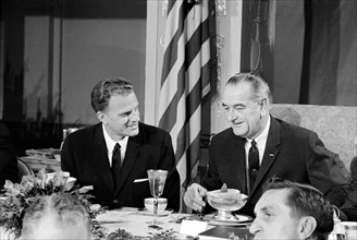Reverend Billy Graham with U.S. President Lyndon Johnson at Annual Presidential Prayer Breakfast, Washington, D.C., USA, photograph by Marion S. Trikosko, February 5, 1964