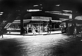 Pedestrians under the Elevated Railway