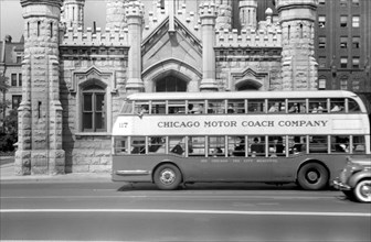 Double Decker Bus in front of Chicago Water Tower