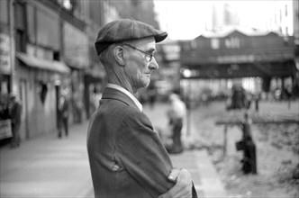 Elderly Man watching Subway Construction