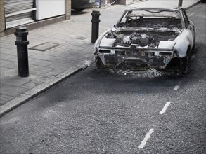 Burnt out Car on Road