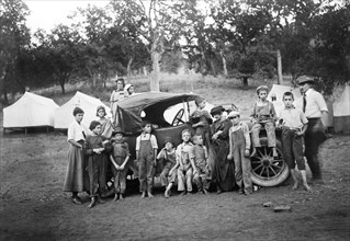 Group Portrait of Children around Car at Kiddie Camp funded and maintained by American Red Cross