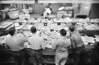 Workers sorting mail at Post Office, New York City, May 1957