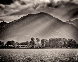 Mountain and Lake with Dramatic Sky and Shadows,,