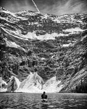 Rear View of Man Kayaking, White Boar Lake,
