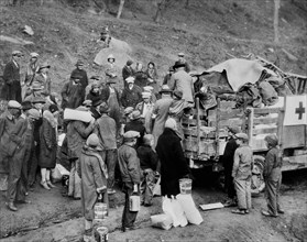 all Drought Victims in isolated Mountain Community, receiving Food Orders from American Red Cross