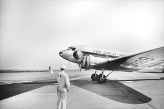 Airplane arriving at Municipal Airport, Washington