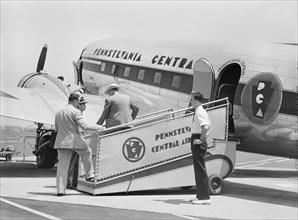 Passengers boarding Airplane, Municipal Airport