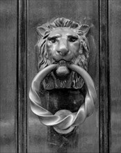Door knocker in the form of a lion's head, Selwyn House, Cleveland Row, Westminster, London, 1979