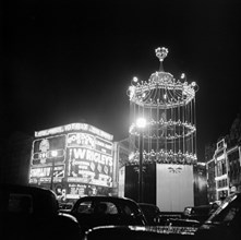 Night scene showing the neon lights of Piccadilly Circus, City of Westminster, c1945-c1965