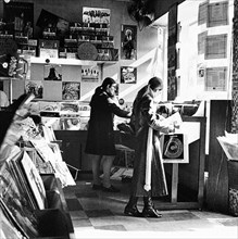 Two women in a London record store, c1960s. Artist: Henry Grant