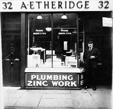 A Etheridge plumber's shop, possibly in Holloway Road, Islington, London, early 20th century. Artist: Henry Grant
