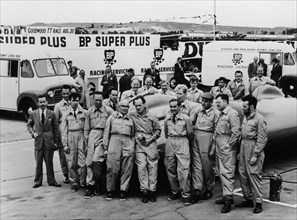 Donald Campbell and the Bluebird team, Goodwood, 22nd July 1960. Artist: Unknown