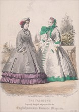 Two women model the latest fashions, 1861. Artist: Anon