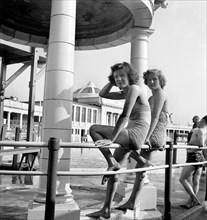 Two bathing beauties pose for the camera in the Blackpool Lido, c1946-c1955