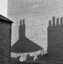 Shadows and laundry, London, 1964