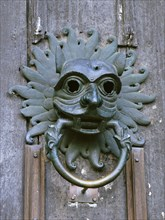 Door knocker in the shape of a mask, sanctuary of Durham Cathedral, County Durham