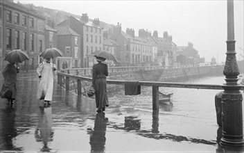 A rainy day on Pier Road, Whitby, North Yorkshire, 1896-1920