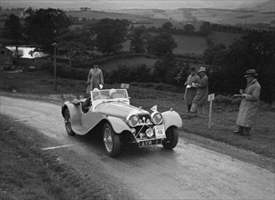 Jaguar SS 100 of Mrs V Hetherington competing in the South Wales Auto Club Welsh Rally, 1937 Artist: Bill Brunell.