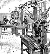 Cutting coin blanks from metal strips, Royal Mint, London, 1897. Artist: Unknown