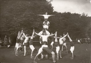 Boys pose in an outdoor gym lesson, 1929. Artist: Unknown