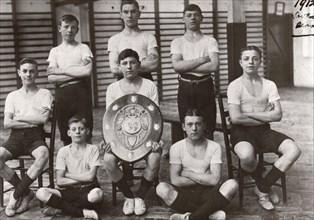 Boys gym team pose with trophy, York,  Yorkshire,1912. Artist: Unknown