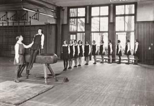 Rowntree girls in an indoor gymnastics class, 1930. Artist: Unknown