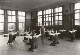 Rowntree girls in an indoor gymnastic class, 1930. Artist: Unknown
