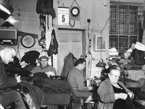 Tailor's workshop, Whitechapel, London, (c1960?) Artist: EH Emanuel