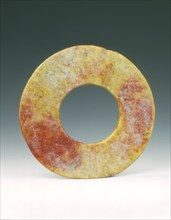 Altered jade bi-disc with russet patches, Neolithic, Liangzhu culture, China, c3400-c2250 BC. Artist: Unknown