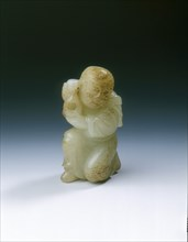 Yellowish jade kneeling tribute bearer, Tang or Liao dynasty, China, 8th-11th century. Artist: Unknown