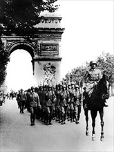 German troops marching on the Champs Elysees, Paris, 14 June 1940. Artist: Unknown