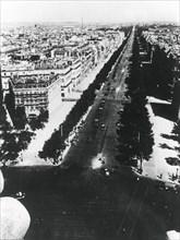 German forces parading along the Champs Elysees, Paris, 14 June 1940. Artist: Unknown