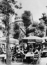 German soldiers relaxing outside a restaurant in Montmartre, Paris, June 1941. Artist: Unknown