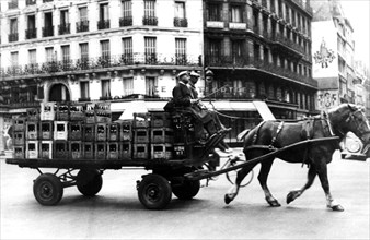 Horse-drawn cart carrying crates of drink, German-occupied Paris, July 1940. Artist: Unknown