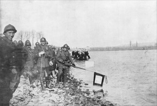 2nd Moroccan division bathes its flags in the Rhine, Huningue, Alsace, France, 21 November 1918. Artist: Unknown