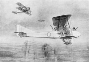 Three-seated aeroplane on a photographic mission, protected by a Spad fighter aircraft, 1918 (1926).Artist: Etienne Cournault