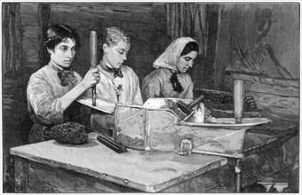 Filling cartridges with dynamite powder at Isleten, near Fluelen, Switzerland, 1893. Artist: Unknown